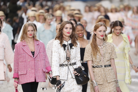 PARIS, FRANCE - OCTOBER 02: Models walk the runway finale during the Chanel show as part of the Paris Fashion Week Womenswear Spring/Summer 2019 on October 2, 2018 in Paris, France. Editorial