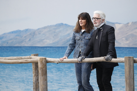 PARIS, FRANCE - OCTOBER 02: Karl Lagerfeld and Virginie Viard walks the runway after the Chanel show as part of the Paris Fashion Week Womenswear Spring/Summer 2019 on October 2, 2018 in Paris, France. Éditoriale