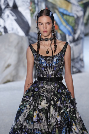 PARIS, FRANCE - OCTOBER 01: A model walks the runway during the Alexander McQueen Paris show as part of the Paris Fashion Week Womenswear SpringSummer 2019 on October 1, 2018 in Paris, France. Editorial