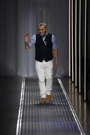 MILAN, ITALY - FEBRUARY 19: Designer Jean-Charles de Castelbajac acknowledges the applause of the audience after the United Colors Of Benetton show at Milan Fashion Week AutumnWinter 201920 on February 19, 2019 in Milan, Italy.