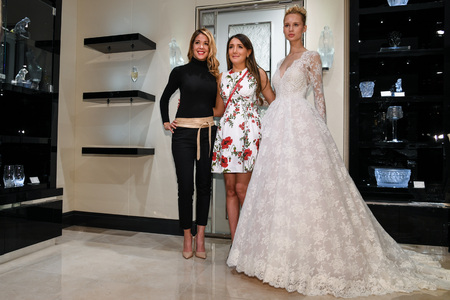 NEW YORK, NY - APRIL 10: Model Milena Garbo (R), designer Grace Accad (C) and guest (L) posing during the Gracy Accad Spring 2020 bridal presentation at Blumingdales on April 10, 2019 in NYC.