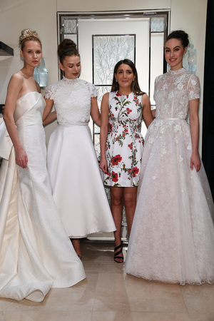 NEW YORK, NY - APRIL 10: Models and designer Gracy Accad (C) prosing during the Gracy Accad Spring 2020 bridal presentation at Blumingdales on April 10, 2019 in NYC. Redactioneel