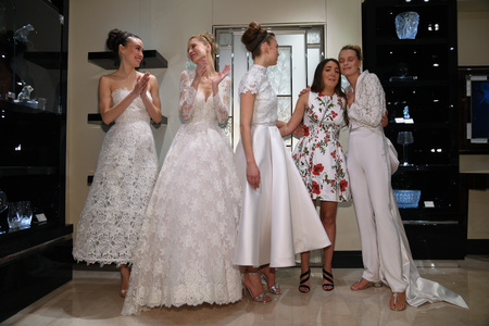 NEW YORK, NY - APRIL 10: Designer Gracy Accad and Models posing for photographers  during the Gracy Accad Spring 2020 bridal presentation at Blumingdales store on April 10, 2019 in NYC. Redactioneel