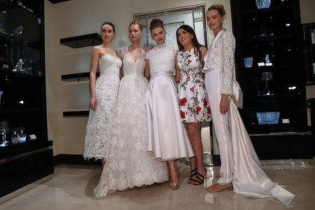 NEW YORK, NY - APRIL 10: Designer Gracy Accad and Models posing for photographers  during the Gracy Accad Spring 2020 bridal presentation at Blumingdales store on April 10, 2019 in NYC. Sajtókép