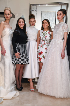 NEW YORK, NY - APRIL 10: Models, designer Gracy Accad (C) and Atelier PR staff prosing during the Gracy Accad Spring 2020 bridal presentation at Blumingdales on April 10, 2019 in NYC.