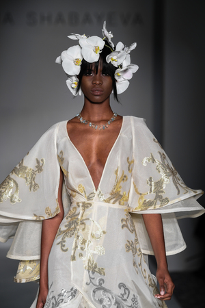 NEW YORK, NY - APRIL 13: A model walks the runway  during the Irina Shabayeva Bridal Spring 2020 fashion collection at New York Fashion Week: Bridal on April 13, 2019 in NYC. Redakční