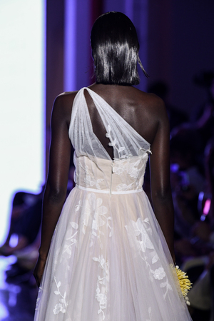 NEW YORK, NY - APRIL 13: A model walks the runway  during the Watters Spring 2020 bridal fashion collection at New York Fashion Week: Bridal on April 13, 2019 in NYC. Sajtókép