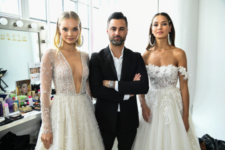 NEW YORK, NY - APRIL 12: Nir Moscovich and models posing backstage before the Berta Bridal Spring 2020 fashion show at New York Fashion Week: Bridal on April 12, 2019 in NYC.