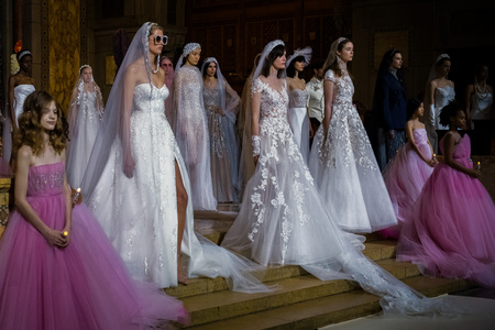 NEW YORK, NY - APRIL 11: Models pose on the runway  during the Reem Acra Bridal Spring 2020 fashion collection at New York Fashion Week: Bridal on April 11, 2019 in NYC.