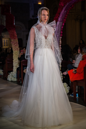NEW YORK, NY - APRIL 11: A model walks the runway  during the Reem Acra Bridal Spring 2020 fashion collection at New York Fashion Week: Bridal on April 11, 2019 in NYC.