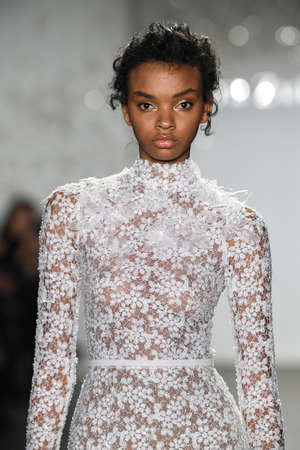 NEW YORK, NY - APRIL 11: A model walks the runway during the Mira Zwillinger Spring 2020 fashion collection at New York Fashion Week: Bridal on April 11, 2019 in NYC. Editorial