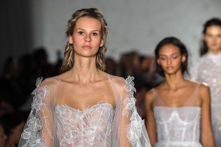 NEW YORK, NY - APRIL 11: Models walk the runway during the Mira Zwillinger Spring 2020 fashion collection at New York Fashion Week: Bridal on April 11, 2019 in NYC.
