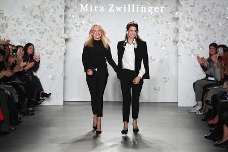 NEW YORK, NY - APRIL 11: (L-R) Designers Mira Zwillinger and Lihi Zwillinger walk the runway at the conclusion of their Mira Zwillinger 2020 Collection during NYFW Bridal on April 11, 2019 in NYC Editorial