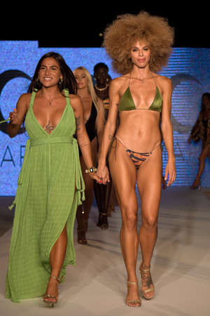 MIAMI, FL - JULY 11: Designer and models walk runway at the Diosa Mar show at Planet Fashion TV show during Fashion Week Swim 2019 on July 11, 2019 in Miami, Florida.