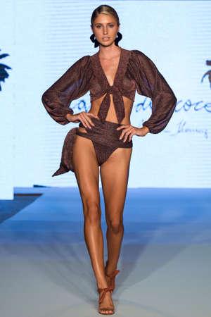 MIAMI, FL - JULY 11: A model walks runway at the  Aqua de Coco show at Planet Fashion TV show during Fashion Week Swim 2019 on July 11, 2019 in Miami, Florida.