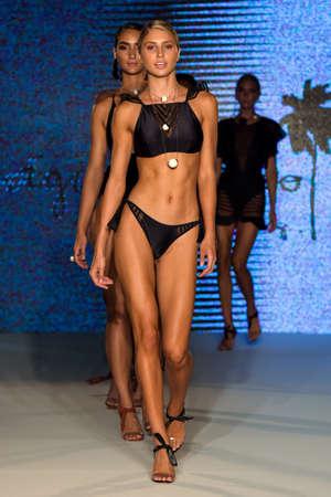 MIAMI, FL - JULY 11: Models walk the runway finale at the Aqua de Coco show at Planet Fashion TV show during Fashion Week Swim 2019 on July 11, 2019 in Miami, Florida. Publikacyjne