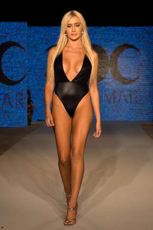 MIAMI, FL - JULY 11: A model walks the runway at the Diosa Mar show at Planet Fashion TV show during Fashion Week Swim 2019 on July 11, 2019 in Miami, Florida. Publikacyjne