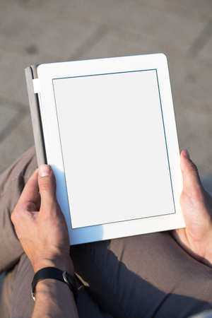 Man with tablet in hands  photo