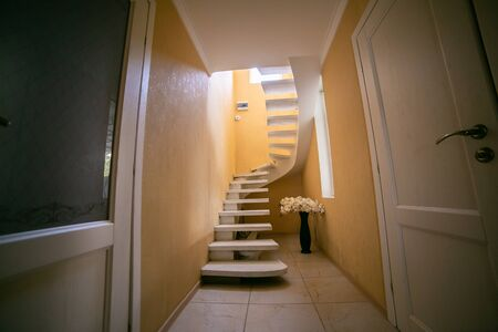 Stairs leading to the upper, low level. Interior design