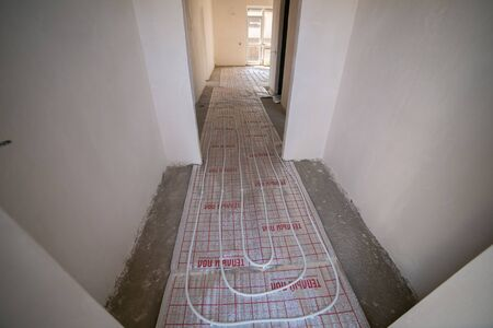 Room in the house apartment right after the renovation. heat-insulated floors electric Foto de archivo