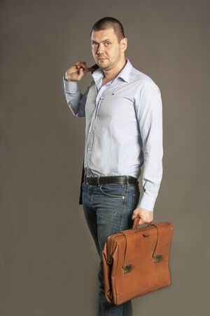Business portrait of a man with a suitcase portfolio retro
