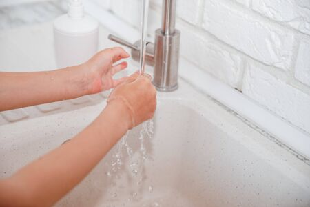 child washing hands with soap and water, detail. hygiene of the child