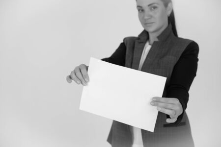 showing blank piece of paper isolated over gray background.