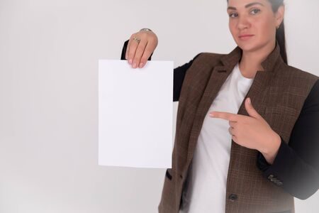 Sign board. successful Business woman holding big white card. Isolated portrait Foto de archivo