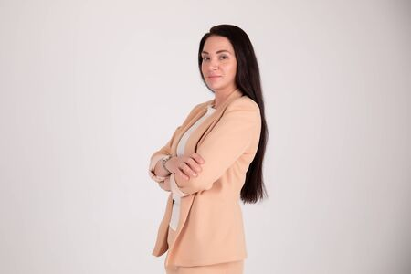 Successful business woman on grey background with copy space. Director in suit Foto de archivo