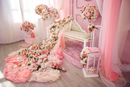 Sofa couch and many flowers abundance pink and white gentle. falls from roses and pioneers