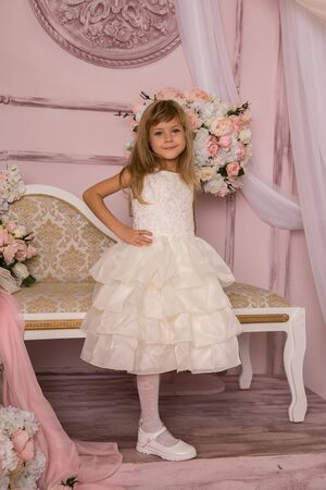 little girl in princess dress with long hair on flower background Foto de archivo
