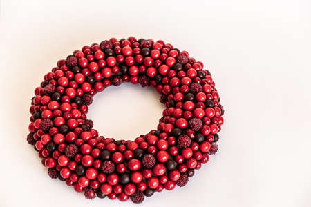Christmas wreath on white background. red wreath circle of berries. Copy Space