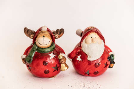 Christmas. New Year's jewelry. gold and red. Christmas deer and santa claus toys