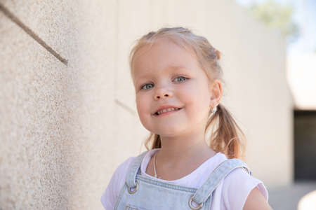 a little girl smiles. large portrait. love