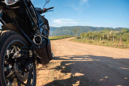 the dirt: Motorcycle and dirt road. Stock Photo