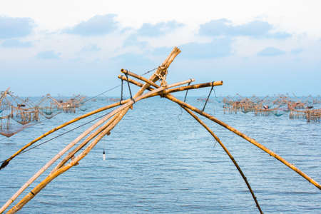 ploy: So many big fish net trap at estuary.