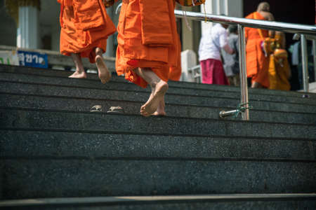 foots: Monk walk to staircase for religious ceremony. Stock Photo