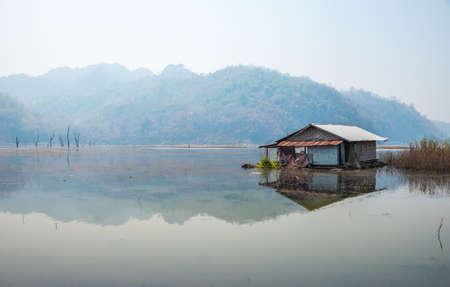 raft: Lagoon, fog, raft among the mountain.