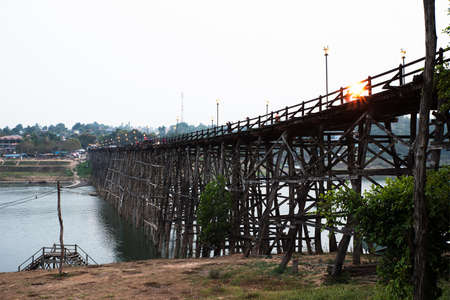 stanchion: SAGKLABURI THAILAND- MARCH 10 : Unidentified tourists are walking cross the longest wood bridge of Thailand on March 10, 2016 at Mon Bridge.
