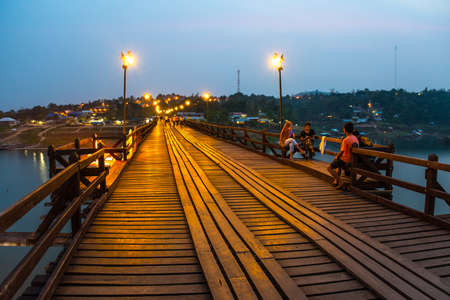 chillout: SAGKLABURI THAILAND- MARCH 10 : Unidentified tourists are chillout at the longest wood bridge of Thailand on March 10, 2016 at Mon Bridge.