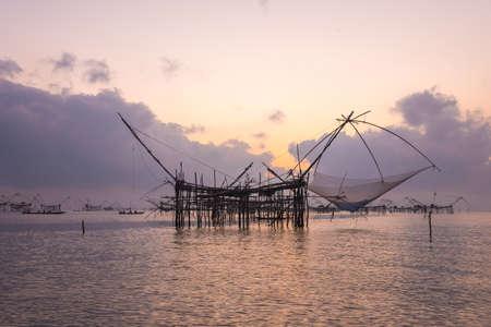 fish net: Silhouette the big fish net trap at dawn under romance sky.