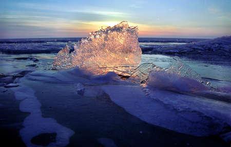 Ice floe and sun on winter Baikal lake Stock Photo - 17607434