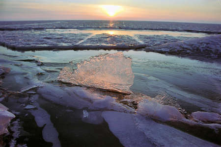 Ice floe and sun on winter Baikal lake Stock Photo - 17607432