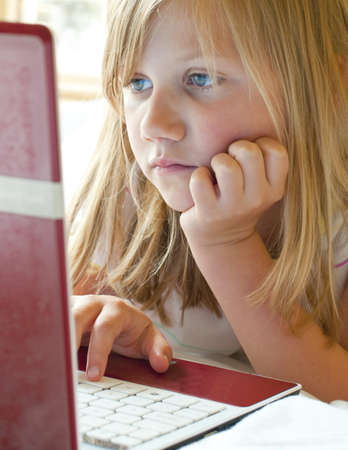 socialise: Young girl on the internet Stock Photo