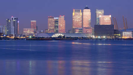 blue toned: Canary wharf at the break of dawn Stock Photo