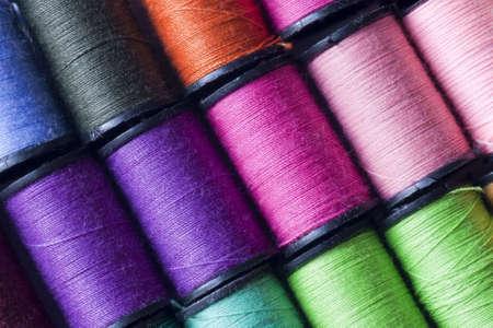 needle and thread: Cotton spools Stock Photo