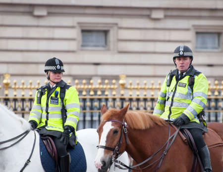 Mounted police officers guarding Buckingham Palace