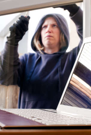Laptop being targeted by burglar photo