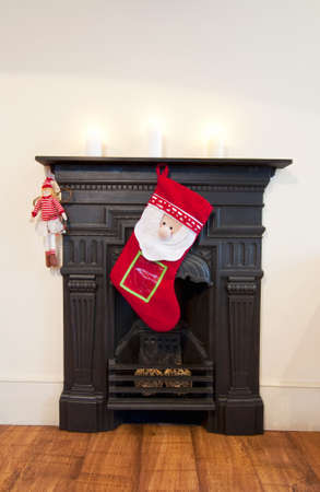 Christmas stocking on victorian fireplace photo