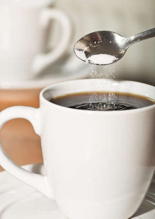 suger: Coffee and spoon of suger